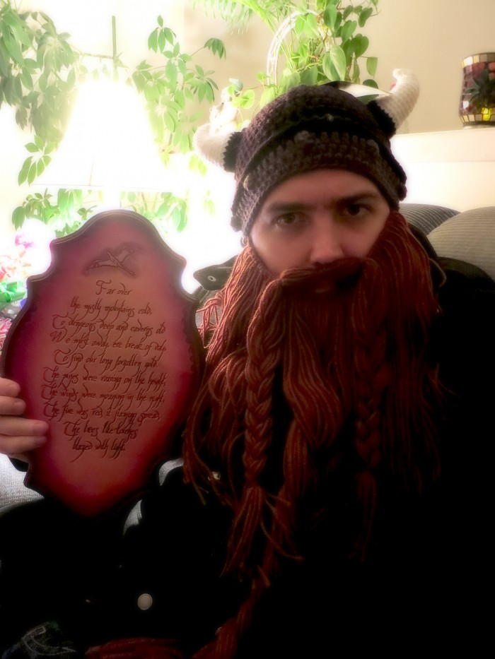 A plaque with the song from the hobbit carved into it. Far over the misty mountains cold